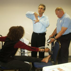 Physical therapists learning laser therapy